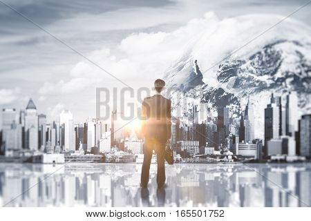 Back view of young man looking at abstract cityscape in space. Double exposure. Research concept.
