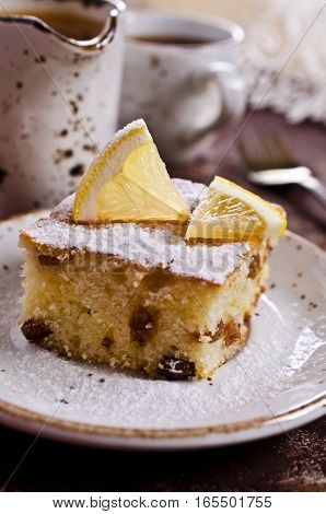 Portion of cake with raisins and lemon. Selective focus.