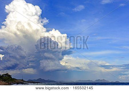 Strong and dark cloud over the Rio de Janeiro sea seen from the Arpoador stone in Ipanema