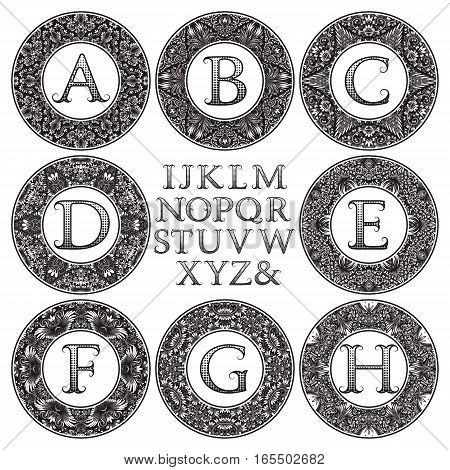 Vintage monogram kit. Black patterned letters and floral round frames for creating initial logo in victorian style.