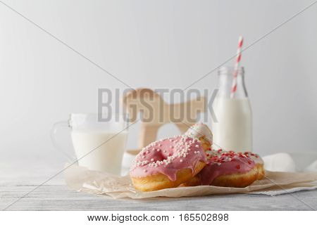 Bottle Of Milk And Donuts On Table