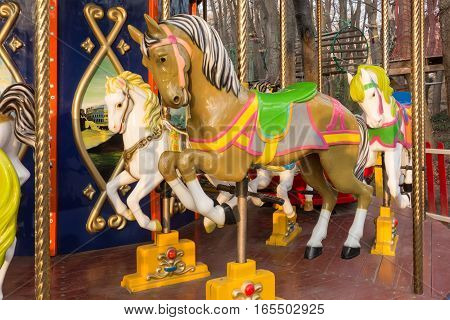 carousel ride with horses in the park