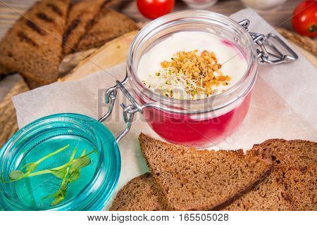 Pate with beet,root and cheese mousse in glass container