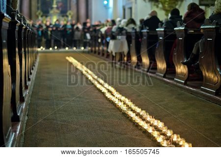 Line of flaming candles in the baroque church
