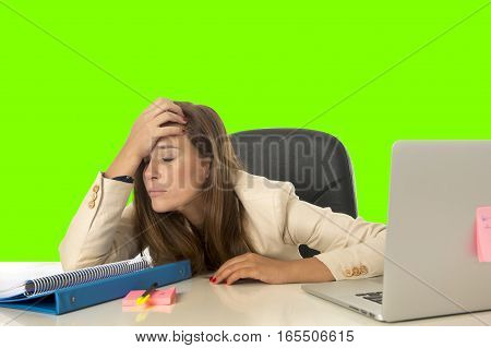 attractive sad desperate business woman suffering stress and headache at office laptop computer desk depressed and overwhelmed isolated green chroma key screen background