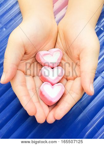 close up pink Marshmallow preserve on woman hand Valentine concept