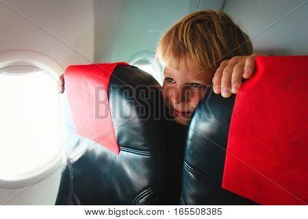 kids travel concept- cute little boy in plane
