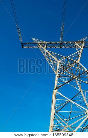 High Voltage Pole Against Clear Sky