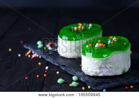 delicious piece of cheesecake on wooden background