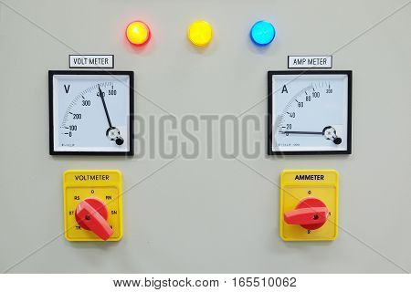 Analog voltmeter, amp meter and signal lamp on control panel of power plant