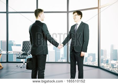Businesspeople Shaking Hands In Room
