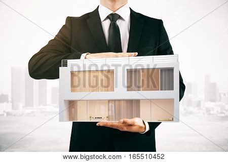 businessman holding modern cottage 3D Rendering. Close up.