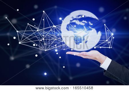 Male hand holding abstract illuminated globe with connections. International business and technologies concept