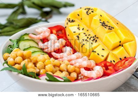 Healthy green salad with mango and shrimp. Love for a healthy food concept