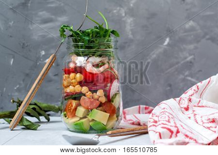 Salad with shrimp and chickpeas in the jar. Love for a healthy food concept