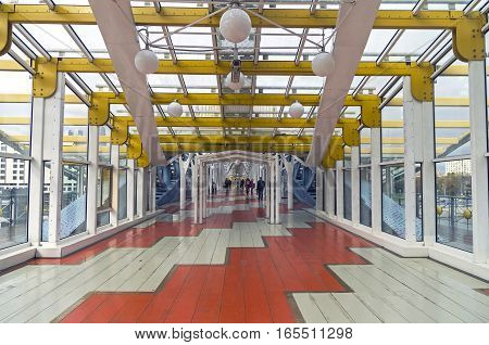 MOSCOW RUSSIA - OCTOBER 2 2016: Inside the pedestrian bridge that connects Berezhkovskaya and Rostov embankments near the Kiev railway station. Moscow Russia.