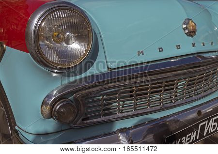 MOSCOW RUSSIA - OCTOBER 1 2016: Old Soviet car Moskvich-403 - headlight and grille.