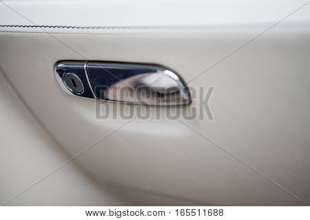 Color detail of the glove compartment in a luxury car.