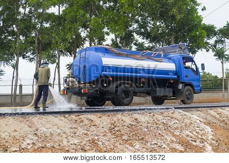 Water cleaning at the road with water truck