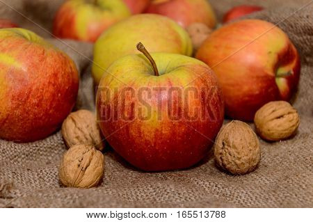 apples with nuts on a sack cloth