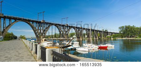 Embankment with arched bridge in Dnepropetrovsk city Ukraine