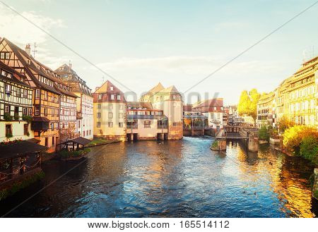 canal and old houses of Petit France medieval district of Strasbourg, France, toned