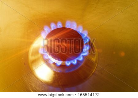The burning torch on the gas stove