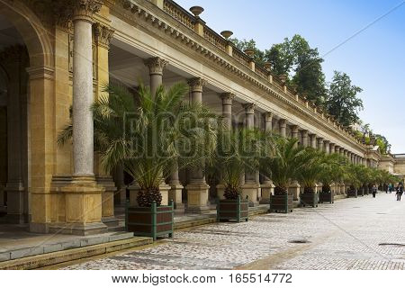 KARLOVY VARY CZECH REPUBLIC - SEPTEMBER 14 2014:Tourist walk along of the Mill Colonnade one of the most historically famous hot springs on September 14 2014 in Karlovy Vary Czech Republic.