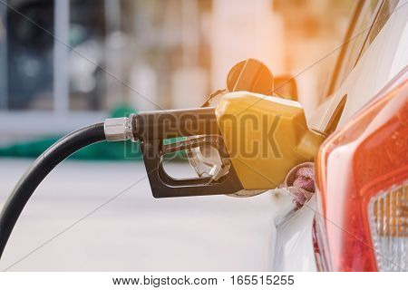 transportation and ownership concept -Pumping gasoline fuel in car at gas station