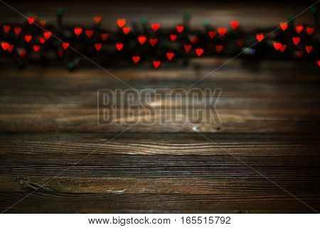 red heart bokeh, Valentine's day concept on wooden background