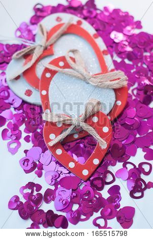 Confetti In The Shape Of Hearts Scattered On The Table.