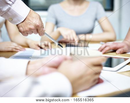 group of asian people meeting in office discussing business plan