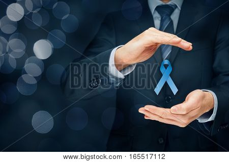 Prostate cancer awareness, peace and genetic disorder awareness - man with protective and support gesture and blue ribbon. Right composition with bokeh in background.