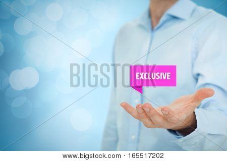 Exclusive offer and exclusivity business model. Businessman hold virtual label with text exclusive. Right composition with bokeh in background.