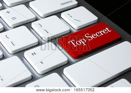 Top Secret on Red Enter Button on white keyboard