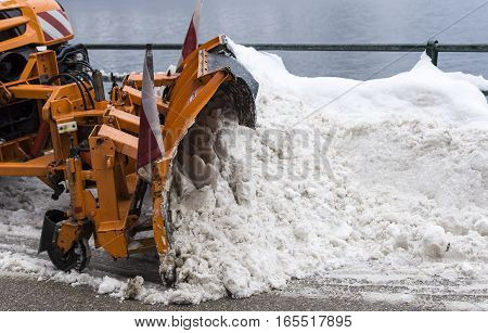 Truck With Snowplough Cleaning Road By Removing Snow From Road After Winter Blizzard