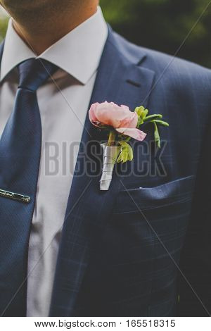 Boutonniere for the groom-pink. Wedding decor groom