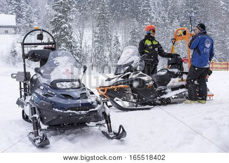 ALTAUSSEE, AUSTRIA - JANUARY 11, 2017 : Mountain Assistance Rescue Patrol with Snowmobiles in Ski Winter Season