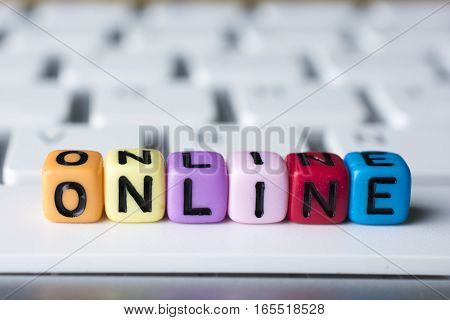 Keyboard with colorful dice and Online word