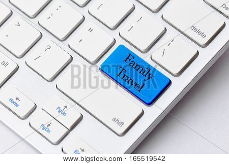 Business concept: Family Travel on computer keyboard background