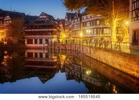 Petit France medieval district of Strasbourg at night, Alsace France, toned