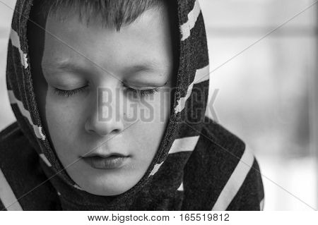 Sad Boy. Teenager With Sad Expression Face Close Up. Depression, Loneliness And Stress Concept.