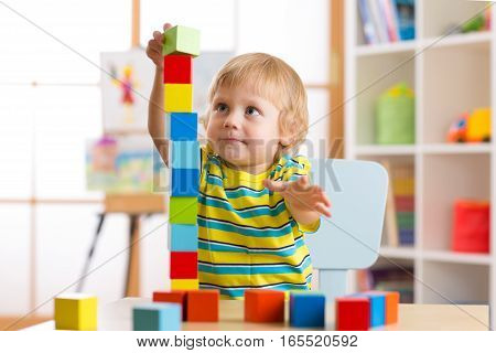 child playing with block toys in day care center