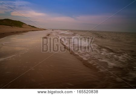 Lonely beach at sunset in prince edward island