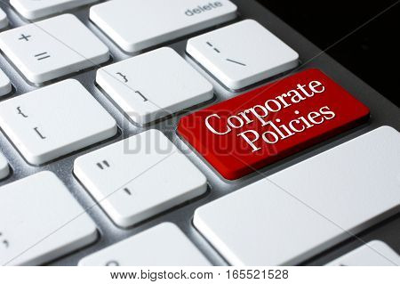 Corporate Policies on Red Enter Button on white keyboard