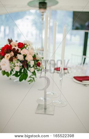 Room table at wedding banquet. Wedding decor