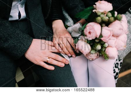 Girl and Guy hold hands. Love, together