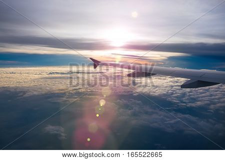 Beautiful view at sunrise from window of airplane