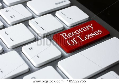 Banking concept: Recovery Of Losses on white keyboard