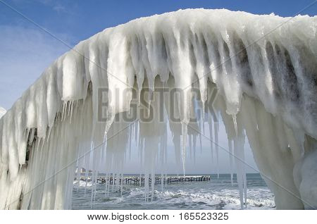 Icy arches from storm in winter on seashore in sunny day Bulgaria